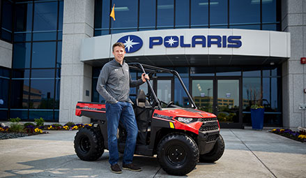 Polaris Product Director Scott Taylor stands next to the RANGER® 150 EFI.