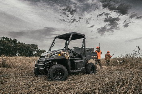 Ranger EV and two hunters in a field