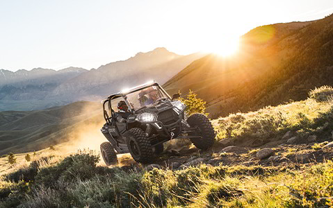 RZR XP 4 1000 in front of a hill