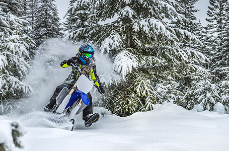 Powering Through the Powder on a Dirt Bike Made for Snow